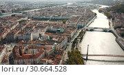 Купить «Panoramic view from drone of cityscape of Lyon in autumn day, France», видеоролик № 30664528, снято 24 октября 2018 г. (c) Яков Филимонов / Фотобанк Лори