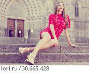 Купить «portrait of young adult girl in evening apparel sitting in european town», фото № 30665428, снято 24 июня 2017 г. (c) Яков Филимонов / Фотобанк Лори