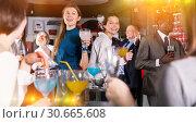 Купить «Two young women drinking cocktails», фото № 30665608, снято 25 марта 2019 г. (c) Яков Филимонов / Фотобанк Лори