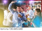 Купить «Drunken man having fun at party», фото № 30665640, снято 25 марта 2019 г. (c) Яков Филимонов / Фотобанк Лори