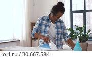Купить «african american woman ironing bed linen at home», видеоролик № 30667584, снято 15 апреля 2019 г. (c) Syda Productions / Фотобанк Лори