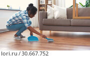 Купить «happy woman with brush and dustpan sweeping floor», видеоролик № 30667752, снято 15 апреля 2019 г. (c) Syda Productions / Фотобанк Лори