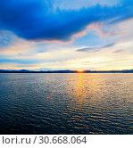 Купить «Sea landscape. Sea water surface lit by sunset light. Summer sunny water scene in colorful tones», фото № 30668064, снято 26 августа 2013 г. (c) Зезелина Марина / Фотобанк Лори
