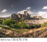 Купить «Kalambaka town and Meteora mountains, Greece», фото № 30676116, снято 4 июля 2018 г. (c) Sergii Zarev / Фотобанк Лори