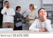 Купить «Unhappy boy during parents and grandma quarreling», фото № 30676580, снято 17 декабря 2017 г. (c) Яков Филимонов / Фотобанк Лори