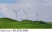 Купить «Group of wind turbines on spring field on a sunny day», видеоролик № 30676968, снято 29 апреля 2019 г. (c) Алексей Кузнецов / Фотобанк Лори