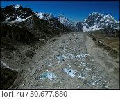 Купить «NEPAL Everest Base Camp -- 16 Apr 2005 -- A view looking south of the massive Khumbu Glacier, just south of Everest Base Camp. Like on many of the world...», фото № 30677880, снято 20 июля 2019 г. (c) age Fotostock / Фотобанк Лори