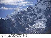 Купить «NEPAL Mount Thamserku -- 23 Sep 2007 -- This image shows the glaciers on the western slopes of Mount Thamserku - a 6608 metre peak in the Himalayas and...», фото № 30677916, снято 7 декабря 2019 г. (c) age Fotostock / Фотобанк Лори