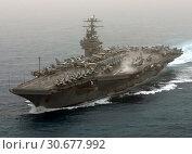 Купить «MEDITERRANEAN SEA -- 20 Mar 2003 -- The USS Theodore Roosevelt (CVN 71) powers through the Mediterranean Sea in support of the invasion of Iraq. US Navy...», фото № 30677992, снято 21 мая 2019 г. (c) age Fotostock / Фотобанк Лори
