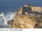 Купить «PORTUGAL Nazare -- 07 Jan 2015 -- Since professional surfers began breaking records in 2011, the Farol da Nazare (Nazare lighthouse) situated on the Forte...», фото № 30678364, снято 7 января 2015 г. (c) age Fotostock / Фотобанк Лори