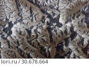 Купить «NEPAL Sagarmatha National Park -- circa. 2004 -- This extraordinary image taken from the International Space Station show the Khumbu Himal or Mahalangur...», фото № 30678664, снято 17 июля 2019 г. (c) age Fotostock / Фотобанк Лори