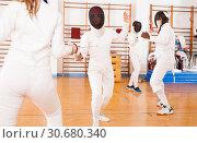 Купить «Fencers exercising techniques in battle», фото № 30680340, снято 11 июля 2018 г. (c) Яков Филимонов / Фотобанк Лори