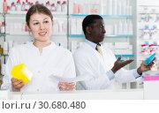 Купить «Experienced woman and man pharmaceutist counseling about medicines», фото № 30680480, снято 2 марта 2018 г. (c) Яков Филимонов / Фотобанк Лори