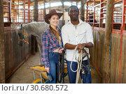 Купить «Portrait of couple of horse farm workers», фото № 30680572, снято 2 октября 2018 г. (c) Яков Филимонов / Фотобанк Лори