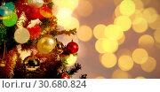Купить «Composite image of defocused of christmas tree lights and fireplace», фото № 30680824, снято 23 октября 2019 г. (c) Wavebreak Media / Фотобанк Лори