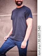 Купить «Hipster man with blank t-shirt for your design», фото № 30681540, снято 26 июня 2019 г. (c) Wavebreak Media / Фотобанк Лори