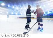 Купить «Composite image of ice hockey players shaking hands at rink», фото № 30682216, снято 18 октября 2019 г. (c) Wavebreak Media / Фотобанк Лори