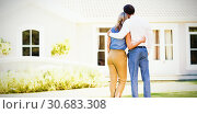 Купить «Rear view of couple standing with arm around», фото № 30683308, снято 22 февраля 2020 г. (c) Wavebreak Media / Фотобанк Лори