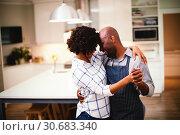 Купить «Romantic couple dancing in kitchen», фото № 30683340, снято 28 мая 2020 г. (c) Wavebreak Media / Фотобанк Лори