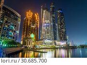 Купить «Abu Dhabi, UAE - March 29. 2019. Complex of skyscrapers - The Etihad Towers and Bab Al Qasr Hotel with night illumination from sea», фото № 30685700, снято 29 марта 2019 г. (c) Володина Ольга / Фотобанк Лори