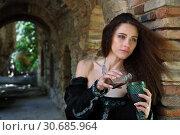 Купить «A beautiful young woman pours some poison into a glass», фото № 30685964, снято 15 апреля 2019 г. (c) Алексей Кузнецов / Фотобанк Лори