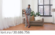 Купить «man with broom cleaning and having fun at home», видеоролик № 30686756, снято 26 апреля 2019 г. (c) Syda Productions / Фотобанк Лори