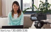 Купить «asian female blogger with camera recording video», видеоролик № 30689536, снято 25 апреля 2019 г. (c) Syda Productions / Фотобанк Лори