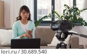 Купить «asian female blogger with camera recording video», видеоролик № 30689540, снято 25 апреля 2019 г. (c) Syda Productions / Фотобанк Лори