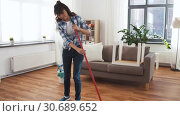 Купить «asian woman with broom sweeping floor and cleaning», видеоролик № 30689652, снято 25 апреля 2019 г. (c) Syda Productions / Фотобанк Лори