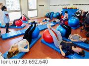 Купить «Matron, Mothers with babies in postpartum gymnastics, Health Center, Zarautz, Gipuzkoa, Basque Country, Spain», фото № 30692640, снято 5 марта 2019 г. (c) age Fotostock / Фотобанк Лори