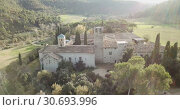 Купить «View from drone of ancient Romanesque monastery Sant Benet de Bagess, Catalonia, Spain», видеоролик № 30693996, снято 24 декабря 2018 г. (c) Яков Филимонов / Фотобанк Лори