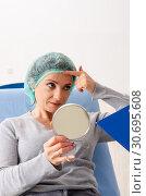Купить «Woman preparing for cosmetic plastic surgery», фото № 30695608, снято 14 ноября 2018 г. (c) Elnur / Фотобанк Лори