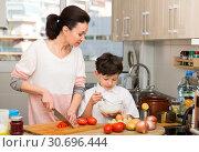 Купить «Woman and her son preparing food», фото № 30696444, снято 28 марта 2019 г. (c) Яков Филимонов / Фотобанк Лори
