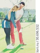 Купить «Golf trainer teaches a woman game», фото № 30696532, снято 27 июня 2019 г. (c) Яков Филимонов / Фотобанк Лори