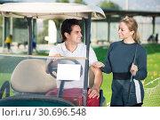 Купить «Young golfers are enjoying game», фото № 30696548, снято 26 июня 2019 г. (c) Яков Филимонов / Фотобанк Лори
