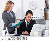 Купить «Businesswoman writing down tasks», фото № 30696588, снято 20 апреля 2017 г. (c) Яков Филимонов / Фотобанк Лори