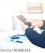 Купить «Man using touchscreen phone», фото № 30696612, снято 20 апреля 2017 г. (c) Яков Филимонов / Фотобанк Лори