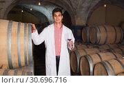 Купить «taster of winery with wine in cellar», фото № 30696716, снято 21 сентября 2016 г. (c) Яков Филимонов / Фотобанк Лори