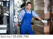 Купить «Portrait of worker in uniform on his workplace», фото № 30696740, снято 26 июля 2017 г. (c) Яков Филимонов / Фотобанк Лори