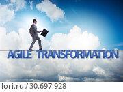 Купить «Agile transformation concept with businessman walking on tight r», фото № 30697928, снято 18 октября 2019 г. (c) Elnur / Фотобанк Лори