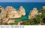 Купить «Pinheiros beach and limestone rocky sea coast near Lagos, Algarve, Portugal», видеоролик № 30699512, снято 21 марта 2019 г. (c) Serg Zastavkin / Фотобанк Лори