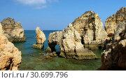 Купить «Bay on Ponta da Piedade with arches, grottos and caves. Lagos, Algarve region, Portugal», видеоролик № 30699796, снято 31 марта 2019 г. (c) Serg Zastavkin / Фотобанк Лори