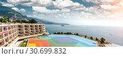 Panoramic view of picturesque seaside and colorful helipad. Monte Carlo, Principality of Monaco (2013 год). Стоковое фото, фотограф Alexander Tihonovs / Фотобанк Лори