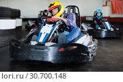 Купить «Portrait of adult man driving racing car», фото № 30700148, снято 18 октября 2019 г. (c) Яков Филимонов / Фотобанк Лори