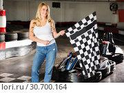 Купить «woman with checkered race flag standing near sport car», фото № 30700164, снято 22 октября 2019 г. (c) Яков Филимонов / Фотобанк Лори