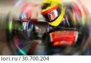 Купить «Portrait of male racer in helmet driving kart on track», фото № 30700204, снято 18 марта 2019 г. (c) Яков Филимонов / Фотобанк Лори