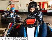 Купить «Woman driving sport car for karting in a circuit lap in sport club», фото № 30700208, снято 18 марта 2019 г. (c) Яков Филимонов / Фотобанк Лори