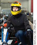 Купить «Fine woman in helmet standing near sport cars», фото № 30700216, снято 18 марта 2019 г. (c) Яков Филимонов / Фотобанк Лори