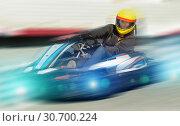 Купить «Girl driving kart at racing track outdoors», фото № 30700224, снято 18 марта 2019 г. (c) Яков Филимонов / Фотобанк Лори