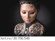 Купить «Portrait a girl with Golden icon painting makeup», фото № 30706540, снято 5 апреля 2019 г. (c) Sergii Zarev / Фотобанк Лори